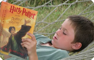 wiggly little boy reading, Harry Potter